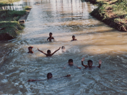 Children swimming in the canal